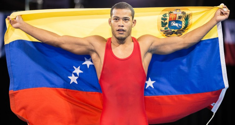 Wuileixis Rivas of Venezuela celebrates his Gold medal win over Bryce Saddoris of the United States in the 66kg class of the men's greco-roman wrestling at the 2015 Pan American Games in Toronto, Canada, July 15,  2015.  AFP PHOTO/GEOFF ROBINS