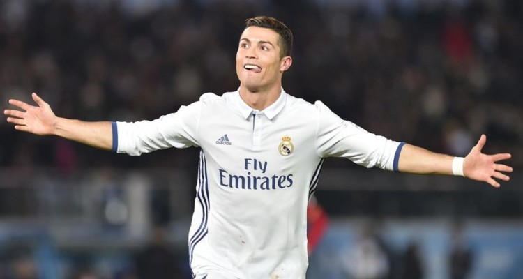 Real Madrid forward Cristiano Ronaldo celebrates scoring during extra-time of the Club World Cup football final match between Kashima Antlers of Japan and Real Madrid of Spain at Yokohama International stadium in Yokohama on December 18  2016    AFP PHOTO   Kazuhiro NOGI