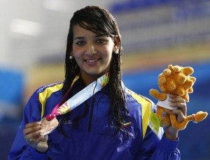 Venezuela's Andreina Pinto poses with her bronze medal after placing third at the women's 800m freestyle final at the Pan American Games in Guadalajara October 19, 2011. REUTERS/Jorge Silva (MEXICO - Tags: SPORT SWIMMING)