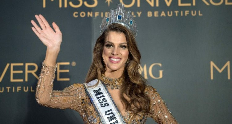 The new Miss Universe Iris Mittenaere of France waves to photographers during a press conference after being crowned the winner at the Miss Universe pageant at the Mall of Asia Arena in Manila on January 30, 2017. France was crowned Miss Universe on January 30 in a glitzy spectacle free of last year's dramatic mix-up but with a dash of political controversy as finalists touched on migration and other hot-button global issues. / AFP / NOEL CELIS