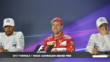 Winner Ferrari's German driver Sebastian Vettel (C), runner-up Mercedes's British driver Lewis Hamilton (L) and third-placed Finnish driver Valtteri Bottas (R) take part in a press conference after the Formula One Australian Grand Prix in Melbourne on March 26, 2017. / AFP PHOTO / PAUL CROCK / --IMAGE RESTRICTED TO EDITORIAL USE - STRICTLY NO COMMERCIAL USE--