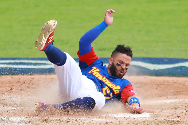 ZAPOPAN, MEXICO - MARCH 11: Jose Altuve #27 of Venezuela slides into home base to score in the top of the fifth inning during the World Baseball Classic Pool D Game 3 between Venezuela and Italy at Panamericano Stadium on March 11, 2017 in Zapopan, Mexico. Miguel Tovar/Getty Images/AFP