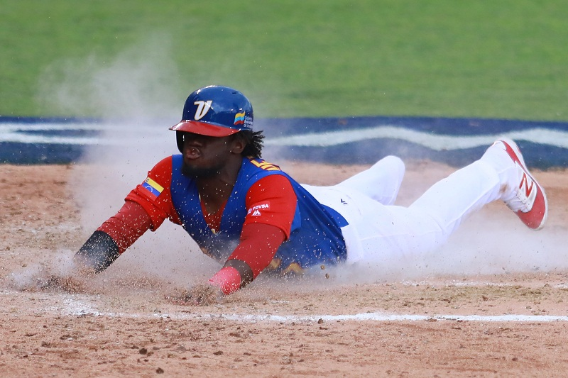 ZAPOPAN, MEXICO - MARCH 11: Odubel Herrera #37 of Venezuela slides into home base to score in the top of the sixth inning during the World Baseball Classic Pool D Game 3 between Venezuela and Italy at Panamericano Stadium on March 11, 2017 in Zapopan, Mexico. Miguel Tovar/Getty Images/AFP