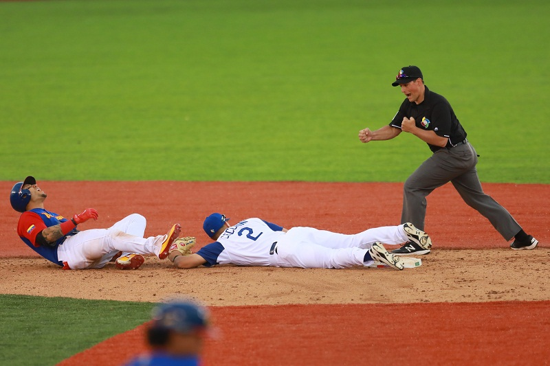 ZAPOPAN, MEXICO - MARCH 11: Carlos Gonzalez #5 of Venezuela is tagged out by Gavin Cecchini #2 of Italy in the top of the sixth inning during the World Baseball Classic Pool D Game 3 between Venezuela and Italy at Panamericano Stadium on March 11, 2017 in Zapopan, Mexico. Miguel Tovar/Getty Images/AFP