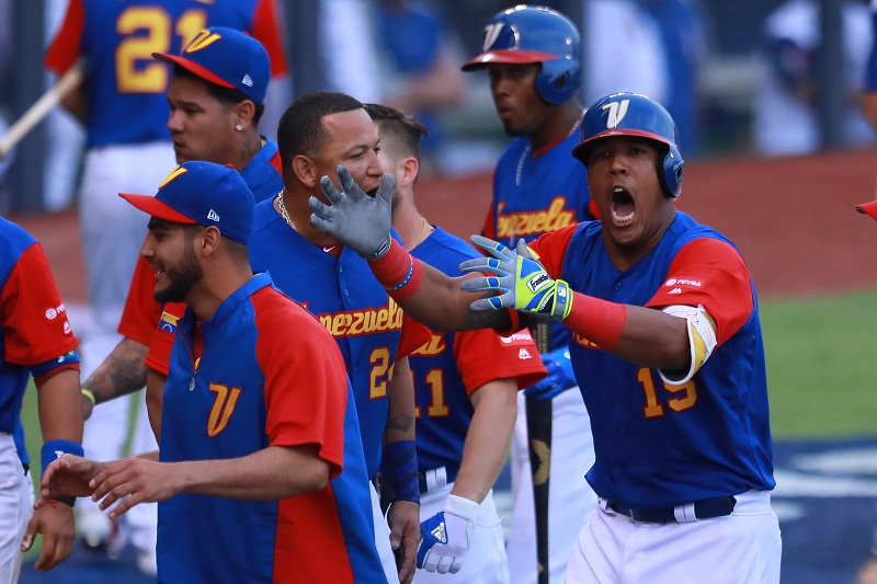 ZAPOPAN, MEXICO - MARCH 11: Salvador Perez #15 of Venezuela celebrates after scoring in the top of the ninth inning during the World Baseball Classic Pool D Game 3 between Venezuela and Italy at Panamericano Stadium on March 11, 2017 in Zapopan, Mexico. Miguel Tovar/Getty Images/AFP