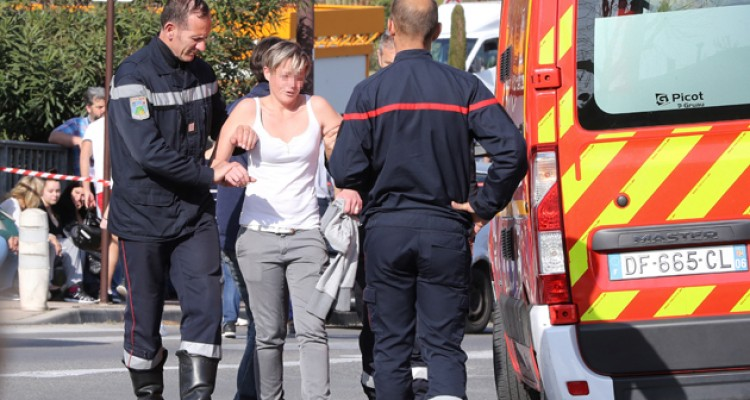 Firefighters help a person to walk toward a vehicle near the Tocqueville high school in the southern French town of Grasse, on March 16, 2017 following a shooting that left eight people injured. At least eight people were injured in a shooting at a high school in the southern French town of Grasse on March 16, 2017 which saw the head teacher targeted, police and local authorities said. One 17-year-old pupil armed with a rifle, two handguns and two grenades was arrested after the shooting at the Tocqueville high school, a police source told AFP, asking not to be named.  / AFP PHOTO / Valery HACHE
