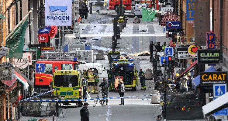 "Emergency services work at the scene where a truck crashed into the Ahlens department store at Drottninggatan in central Stockholm, April 7, 2017.  A truck slammed into a crowd of people outside a busy department store in central Stockholm on Friday, causing ""deaths"" in what the prime minister described as a ""terror attack.""  / AFP PHOTO / TT NEWS AGENCY AND TT News Agency / Fredrik Sandberg / Sweden OUT"