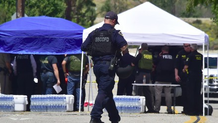 Law enforcement personnel set up station outside the North Park Elementary School in San Bernadino, California on April 10, 2017 after a gunman entered a classroom and killed one woman and one student before turning the gun on himself.  / AFP PHOTO / FREDERIC J. BROWN