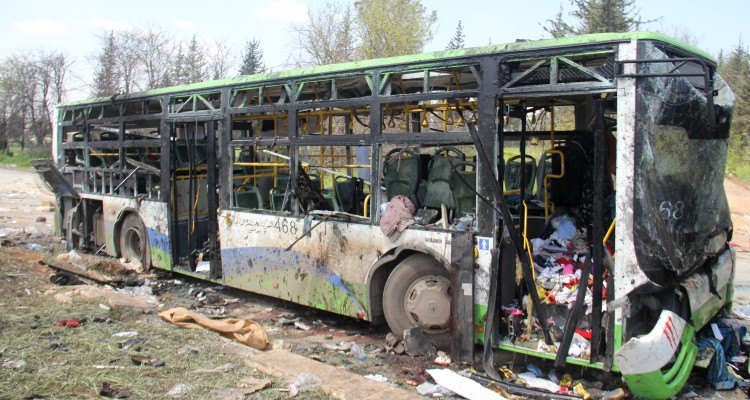 A picture taken on April 16, 2017, shows the damage a day after a suicide car bombing attack in Rashidin, west of Aleppo, targeted busses carrying Syrians evacuated from two besieged government-held towns of Fuaa and Kafraya. A massive car bomb attack on a convoy carrying evacuees from besieged government-held towns in Syria killed more than 100 people and wounded hundreds, a monitor said. / AFP PHOTO / Omar haj kadour