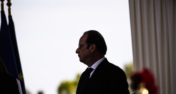 French President Francois Hollande attends a ceremony marking the 102nd anniversary of the Armenian genocide, in Paris, on April 24, 2017. Armenians say up to 1.5 million people were killed during World War I as the Ottoman Empire was falling apart, a claim supported by many other countries. Turkey fiercely rejects the genocide label, arguing that 300,000 to 500,000 Armenians and at least as many Turks died in civil strife when Armenians rose up against their Ottoman rulers and sided with invading Russian troops. / AFP PHOTO / POOL / Christophe Petit Tesson
