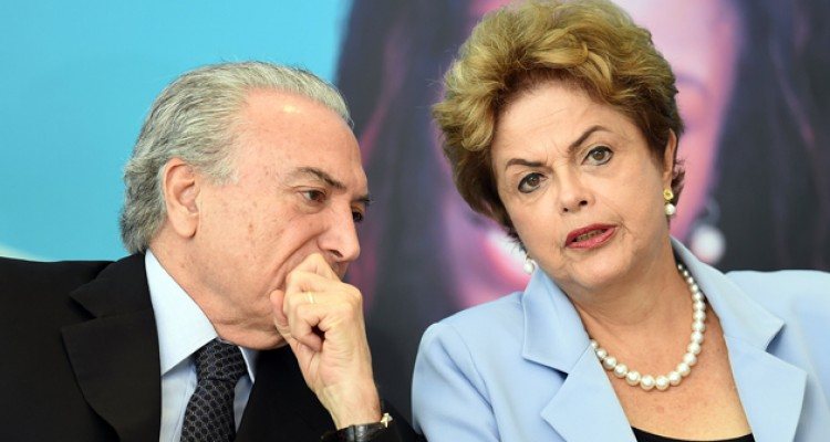 (FILES) This file photo taken on August 11, 2015 shows Brazilian President Dilma Rousseff (R) and Vice-President Michel Temer attending the launching ceremony of the Investment Program in Energy at Planalto Palace in Brasilia. Brazil's Supreme Electoral Court met on April 4, 2017 on whether to invalidate the 2014 presidential election because of illegal campaign funding -- a ruling that could in theory force out President Michel Temer. At issue are allegations that when then president Dilma Rousseff ran for re-election in 2014, with Temer as vice president, their ticket was financed by undeclared funds or bribes. Both Temer and Rousseff deny any wrongdoing. / AFP PHOTO / EVARISTO SA