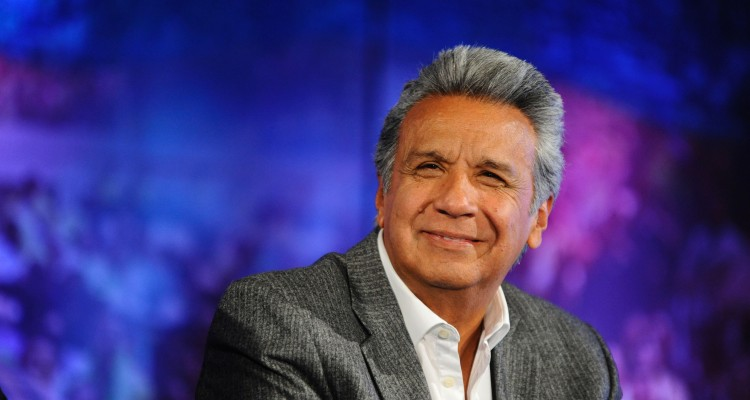 Ecuadorean President-elect Lenin Moreno receives the final official results of Sunday's runoff election at the House of Alianza Pais in Quito, on April 4, 2017. Ecuador's electoral authority confirmed Tuesday that Moreno, the ruling party candidate, won the presidential runoff election. / AFP / JUAN RUIZ