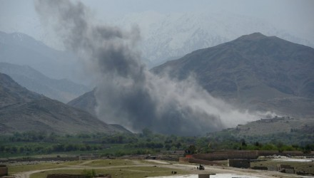 In this photograph taken on April 11, 2017, smoke rises after an air strike by US aircraft on positions during an ongoing an operation against Islamic State (IS) militants in the Achin district of Afghanistan's Nangarhar province. An American special forces soldier has been killed while conducting operations against the Islamic State group in Afghanistan, the US military said. The US-backed Afghan military has vowed to wipe out the group in its strongholds in the eastern province of Nangarhar as IS challenges the more powerful Taliban on its own turf. / AFP PHOTO / NOORULLAH SHIRZADA        (Photo credit should read NOORULLAH SHIRZADA/AFP/Getty Images)