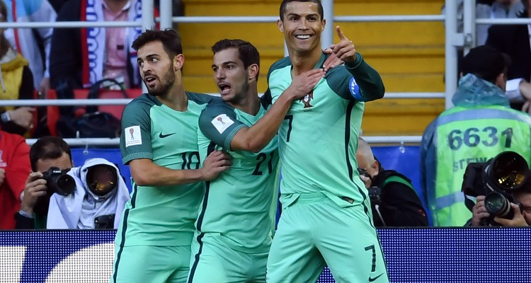 (From R) Portugal's forward Cristiano Ronaldo celebrates with Portugal's defender Cedric and Portugal's midfielder Bernardo Silva after scoring during the 2017 Confederations Cup group A football match between Russia and Portugal at the Spartak Stadium in Moscow on June 21, 2017. / AFP PHOTO / Kirill KUDRYAVTSEV
