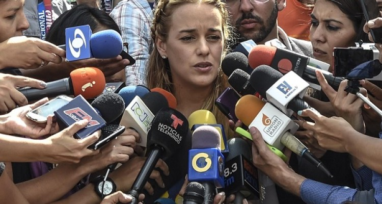 Lilian Tintori, wife of Venezuelan political prisoner and opposition leader Leopoldo Lopez, speaks to the press during a demonstration marking 100 days of protests against President Nicolas Maduro in Caracas, on July 9, 2017. Venezuela hit its 100th day of anti-government protests on Sunday, one day after its most prominent political prisoner, Leopoldo Lopez, vowed to continue his fight for freedom after being released from jail and placed under house arrest. At least 91 people have died since non-stop street protests began on April 1. / AFP PHOTO / Juan BARRETO