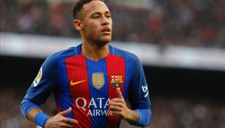 FILES  This file photo taken on December 3  2016 shows Barcelona s Brazilian forward Neymar running on the pitch during the Spanish league football match FC Barcelona vs Real Madrid CF at the Camp Nou stadium in Barcelona  The Spanish court validated on December 20  2016 the agreement between the prosecution and FC Barcelona to avoid a trial for the signing of Brazilian Neymar in which the club pleads guilty to two tax offenses  The pact reached in June exonerated the president of Barca  Josep Maria Bartomeu  and his predecessor  Sandro Rosell  and imposed a fine on the club of 5 5 million euros for these crimes against the public treasury    AFP PHOTO   PAU BARRENA