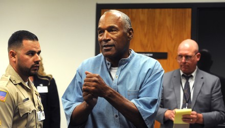 "O.J. Simpson (C) reacts after learning he was granted parole during his parole hearing at the Lovelock Correctional Center in Lovelock, Nevada on July 20, 2017. Disgraced former American football star O.J. Simpson was granted his release from prison on Thursday after serving nearly nine years behind bars for armed robbery.A four-member parole board in the western US state of Nevada voted unanimously to free the 70-year-old Simpson after a public hearing broadcast live by US television networks. / AFP PHOTO / POOL / Jason Bean / RESTRICTED TO EDITORIAL USE - MANDATORY CREDIT ""AFP PHOTO /POOL/Reno Gazette-Journal/ Jason Bean"" - NO MARKETING NO ADVERTISING CAMPAIGNS - DISTRIBUTED AS A SERVICE TO CLIENTS"