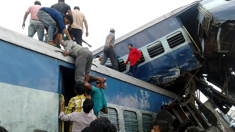 Local residents look for survivors on the wreckage of train carriages after an express train derailed near the town of Khatauli in the Indian state of Uttar Pradesh on August 19, 2017. Ten people were killed and dozens injured when an express train derailed in north India on August 19, an official said.Emergency workers were pulling people out of mangled, upended carriages after 14 coaches derailed near Muzaffarnagar district in Uttar Pradesh state, some 130 kilometres (80 miles) from New Delhi.   / AFP PHOTO / -