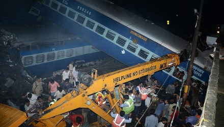Emergency workers look for survivors on the wreckage of a train carriage after an express train derailed near the town of Khatauli in the Indian state of Uttar Pradesh on August 19, 2017. Ten people were killed and dozens injured when an express train derailed in north India on August 19, an official said.Emergency workers were pulling people out of mangled, upended carriages after 14 coaches derailed near Muzaffarnagar district in Uttar Pradesh state, some 130 kilometres (80 miles) from New Delhi.   / AFP PHOTO / -