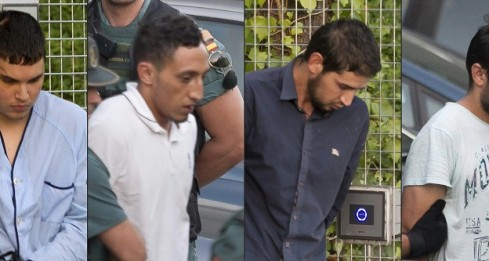 (COMBO) This combination of pictures created on August 22, 2017 shows (from L) Mohamed Houli Chemlal, Driss Oukabir, Salah El Karib, and Mohamed Aallaa, suspected of involvement in the terror cell that carried out twin attacks in Barcelona and Cambrils, escorded by Spanish Civil Guards from a detention center in Tres Cantos, near Madrid, on August 22, 2017 before being tranferred to the National Court.  Under heavy security, police vans entered the National Court, which deals with terrorism cases, where a judge will question them and decide what -- if any -- charges to press against them over the vehicle attacks that left 15 dead and 120 injured. / AFP PHOTO / STRINGER
