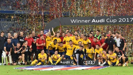 The team of Atletico Madrid celebrate with the trophy during the winner ceremony after the final Audi Cup football match between Atletico Madrid and FC Liverpool in the stadium in Munich, southern Germany, on August 2, 2017.  Atletico Madrid won the final after penalty.   / AFP PHOTO / Christof STACHE
