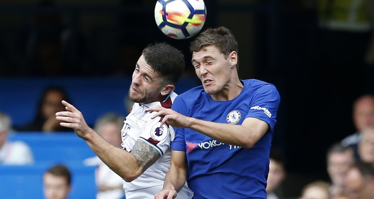 Burnley's Irish midfielder Robbie Brady (L) vies with Chelsea's Danish defender Andreas Christensen during the English Premier League football match between Chelsea and Burnley at Stamford Bridge in London on August 12, 2017. / AFP PHOTO / Ian KINGTON / RESTRICTED TO EDITORIAL USE. No use with unauthorized audio, video, data, fixture lists, club/league logos or 'live' services. Online in-match use limited to 75 images, no video emulation. No use in betting, games or single club/league/player publications.  /