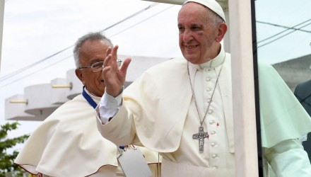 """Handout picture released by L'Osservatore Romano showing Pope Francis -bearing a bruise around his left eye and eyebrow caused by an accidental hit against the popemobile's window glass- waving on his way to the St Peter Claver Church, in Cartagena, Colombia, on September 10, 2017. Nearly 1.3 million worshippers flocked to a mass by Pope Francis on Saturday in Medellin,  the Colombian city known as the stronghold of the late drug lord Pablo Escobar. / AFP PHOTO / OSSERVATORE ROMANO / HO / RESTRICTED TO EDITORIAL USE - MANDATORY CREDIT """"AFP PHOTO / OSSERVATORE ROMANO"""" - NO MARKETING NO ADVERTISING CAMPAIGNS - DISTRIBUTED AS A SERVICE TO CLIENTS"""