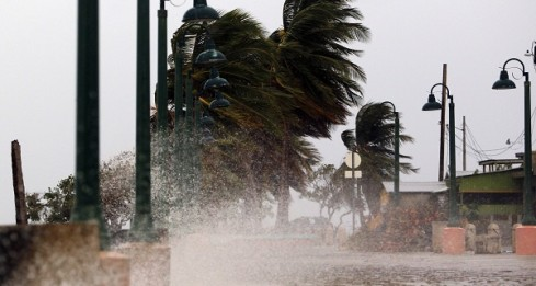 """Winds lash the coastal city of Fajardo as Hurricane Maria approaches Puerto Rico, on September 19, 2017.  Maria headed towards the Virgin Islands and Puerto Rico after battering the eastern Caribbean island of Dominica, with the US National Hurricane Center warning of a """"potentially catastrophic"""" impact. / AFP PHOTO / Ricardo ARDUENGO"""
