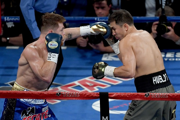 LAS VEGAS, NV - SEPTEMBER 16: (L-R) Canelo Alvarez throws a punch at Gennady Golovkin during their WBC, WBA and IBF middleweight championship bout at T-Mobile Arena on September 16, 2017 in Las Vegas, Nevada.   Ethan Miller/Getty Images/AFP