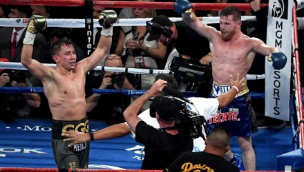 LAS VEGAS, NV - SEPTEMBER 16: (L-R) Gennady Golovkin and Canelo Alvarez both celebrate after the final round in their WBC, WBA and IBF middleweight championship bout at T-Mobile Arena on September 16, 2017 in Las Vegas, Nevada.   Ethan Miller/Getty Images/AFP