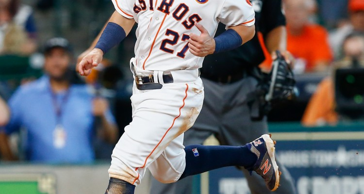HOUSTON, TX - SEPTEMBER 02: Jose Altuve #27 of the Houston Astros scores on a wild pitch in the second inning against the New York Mets in game one of a double-header at Minute Maid Park on September 2, 2017 in Houston, Texas.   Bob Levey/Getty Images/AFP