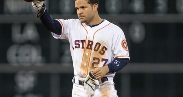 Sep 16, 2014; Houston, TX, USA; Houston Astros second baseman Jose Altuve (27) tips his helmet after hitting a double during the fifth inning against the Cleveland Indians at Minute Maid Park. Altuve tied an Astros record with 210 hits in a season. Mandatory Credit: Troy Taormina-USA TODAY Sports