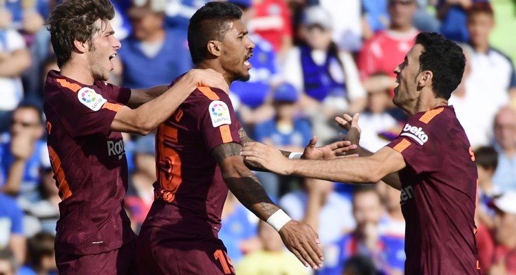 Barcelona's midfielder from Brazil Paulinho (C) celebrates a goal with Barcelona's midfielder from Spain Sergi Roberto (L) and Barcelona's midfielder from Spain Sergio Busquets during the Spanish league football match Getafe CF vs FC Barcelona at the Col. Alfonso Perez stadium in Getafe on September 16, 2017. / AFP PHOTO / PIERRE-PHILIPPE MARCOU