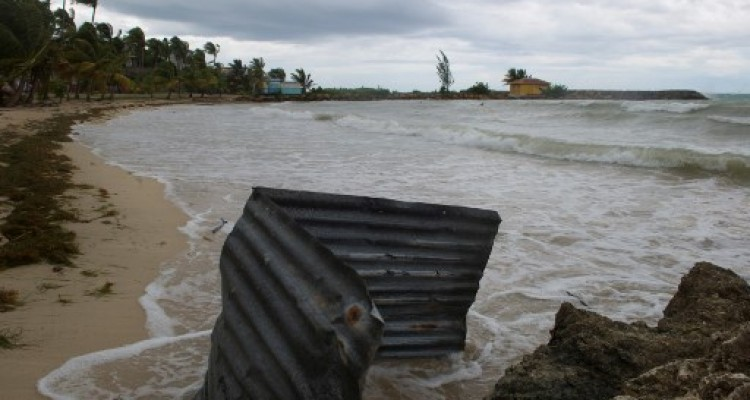 A picture taken on September 6, 2017 shows a general view of the Pointe de la Verdure beach in Gosier, on the French overseas island of Guadeloupe, as high winds from Hurricane Irma hit the island. Monster Hurricane Irma slammed into Caribbean islands today after making landfall in Barbuda, packing ferocious winds and causing major flooding in low-lying areas. As the rare Category Five storm barreled its way across the Caribbean, it brought gusting winds of up to 185 miles per hour (294 kilometers per hour), weather experts said.  / AFP PHOTO / Helene Valenzuela