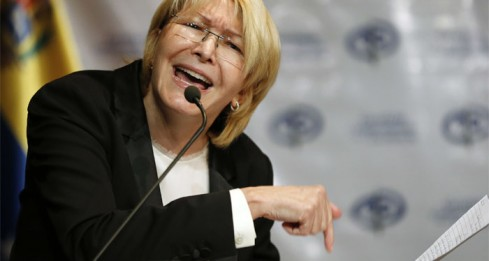 FILE - In this July 4, 2017 file photo, Venezuela's Chief Prosecutor Luisa Ortega Diaz gives a press conference in Caracas, Venezuela. Until recently, Ortega was seen as a hardline loyalist, responsible for scores of arrests on trumped-up charges against anti-government protesters. Now she's being lionized by the opposition and disaffected supporters of the late Hugo Chavez alike for her decision to break with El Comandante's hand-picked successor. (AP Photo/Ariana Cubillos, File)