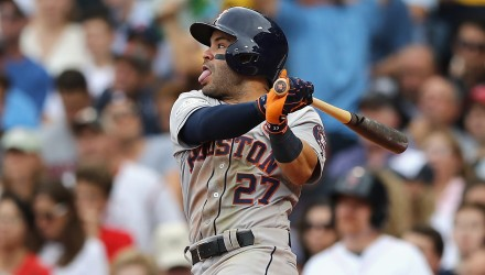BOSTON, MA - OCTOBER 08: Jose Altuve #27 of the Houston Astros hits a single in the fifth inning against the Boston Red Sox during game three of the American League Division Series at Fenway Park on October 8, 2017 in Boston, Massachusetts.   Elsa/Getty Images/AFP
