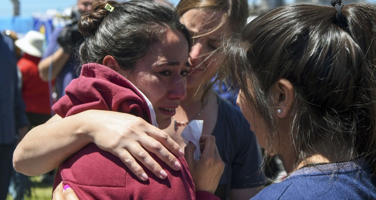 "A relative of one of the 44 crew members of Argentine missing submarine, is comforted outside Argentina's Navy base in Mar del Plata, on the Atlantic coast south of Buenos Aires, on November 23, 2017. An unusual noise heard in the ocean near the last known position of the San Juan submarine was ""consistent with an explosion,"" Argentina's navy announced Thursday. ""An anomalous, singular, short, violent and non-nuclear event consistent with an explosion,"" occurred shortly after the last communication of the San Juan and its 44 crew, navy spokesman Captain Enrique Baldi told a news conference in Buenos Aires.  / AFP PHOTO / EITAN ABRAMOVICH"