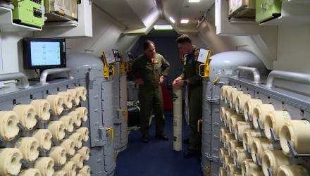 This video grab shows members of the U.S. Navy Patrol and Reconnaissance Wing (CPRW) 11 on a P8-A Poseidon aircraft assisting the Argentine military in their search for the missing Argentine submarine ARA San Juan, taking off from the Bahia Blanca naval base in Buenos Aires province on November 26, 2017. / AFP PHOTO / CARLOS REYES