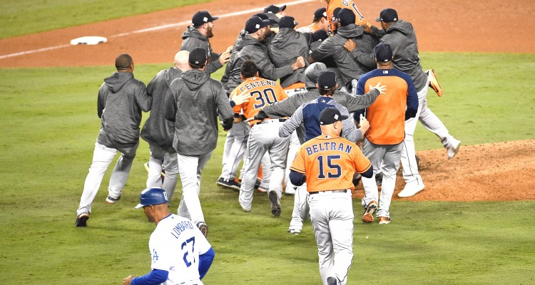 LOS ANGELES, CA - NOVEMBER 01: The Houston Astros celebrate defeating the Los Angeles Dodgers 5-1 in game seven to win the 2017 World Series at Dodger Stadium on November 1, 2017 in Los Angeles, California.   Kevork Djansezian/Getty Images/AFP
