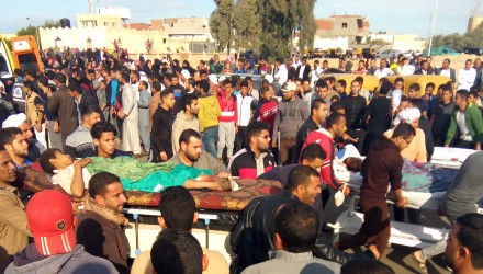 Egyptians carry victims on stretchers following a gun and bombing attack on the Rawda mosque near the North Sinai provincial capital of El-Arish on November 24, 2017. Armed attackers killed at least 235 worshippers in a bomb and gun assault on the packed mosque in Egypt's restive North Sinai province, in the country's deadliest attack in recent memory.   / AFP PHOTO / -
